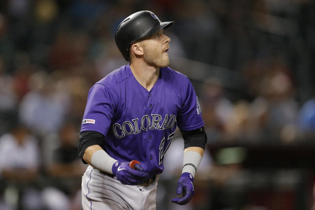 Colorado Rockies' Trevor Story watches his RBI single against the Arizona Diamondbacks during the seventh inning of a baseball game Tuesday, Aug. 20, 2019, in Phoenix. (AP Photo/Rick Scuteri)