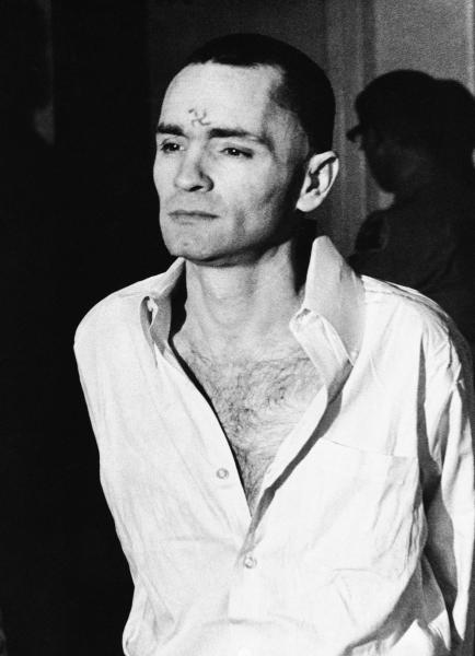 FILE - In this March 12, 1971 file photo, Charles Manson, with a swastika on his forehead, walks to court in Los Angeles, during the the penalty phase of the Sharon Tate trial after being convicted of murder in the deaths of Tate and six others. Authorities say Manson, cult leader and mastermind behind 1969 deaths of actress Sharon Tate and six others, died on Sunday, Nov. 19, 2017. He was 83. (AP Photo, File)