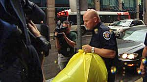 Police remove a bag containing a human foot that was delivered to the Conservative Party of Canada's headquarters in downtown Ottawa.
