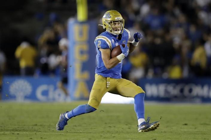 UCLA wide receiver Kyle Philips (2) runs against Arizona State during the second half.