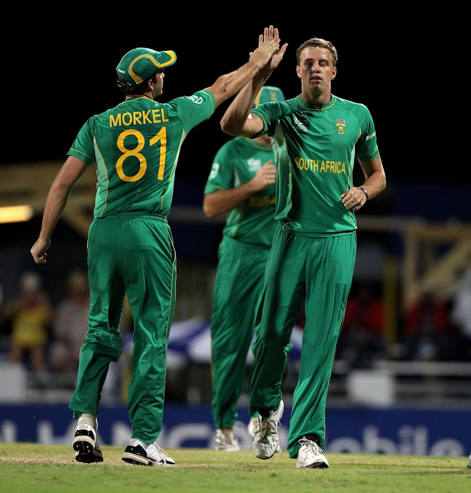BRIDGETOWN, BARBADOS - MAY 05: Morne Morkel (R) is congratulated by Albie Morkel for the wicket of Nowroz Mangal of Afghanistan during The ICC World Twenty20 Group C Match between South Africa and Afghanistan played at The Kensington Oval on May 5, 2010 in Bridgetown, Barbados.  (Photo by Julian Herbert/Getty Images)