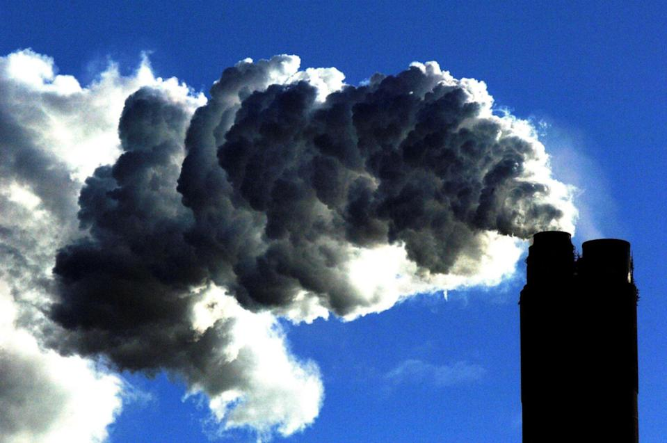 Smoke billows into the air from a coal fired power plant. The UK has committed to bringing greenhouse gases to zero by 2050John Giles/PA