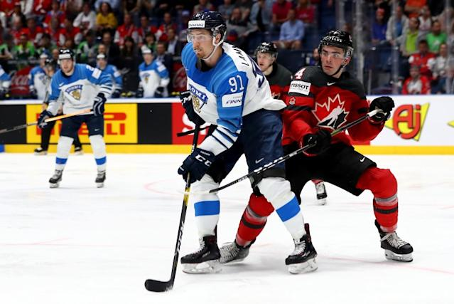 "Canada's Dante Fabbro, right, defends against Finland's Juha Lammikko during the 2019 IIHF championship game. <span class=""copyright"">(Martin Rose / Getty Images)</span>"