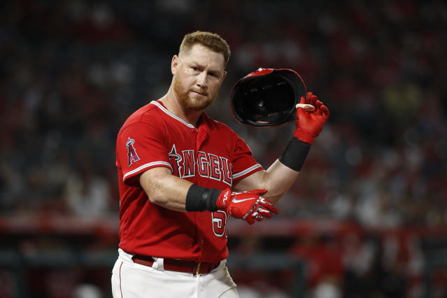 Los Angeles Angels' Kole Calhoun takes off his helmet after he grounded out during the eighth inning of the team's baseball game against the Seattle Mariners, Wednesday, July 11, 2018, in Anaheim, Calif. (AP Photo/Jae C. Hong)