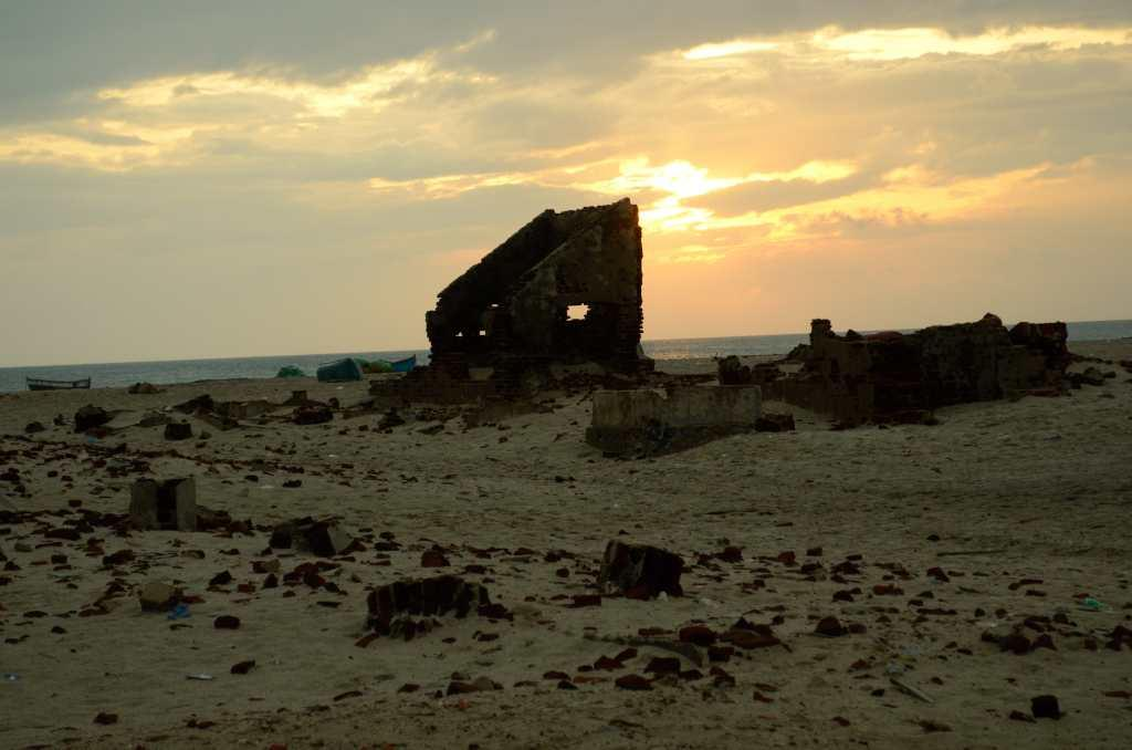 "<b>12.	Dhanushkodi, Tamil Nadu </b><br><br>One would wonder how a vast, empty seaside town washed away by a tsunami 50 years ago falls into a list of must-see destinations. There is nothing left in Dhanushkodi today. Located at the tip of Rameshwaram it is the only land border between Sri Lanka and India. Yet the ruins of this town tell a poignant tale as you see the remains of a railway line and a station that were engulfed by nature's fury. Travellers speak of the railway connection to Sri Lanka, which today lies hidden in rubble. Go to the tip of Dhanuskodi if the weather holds, for here you can see the oceans meet.<br><br><b>READ MORE:</b> <a target=""_blank"" href=""http://in.lifestyle.yahoo.com/photos/dhanushkodi-at-land-s-end-slideshow/"">At land's end</a>"