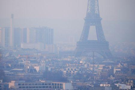 The Eiffel Tower is surrounded by a small-particle haze which hangs above the skyline in Paris