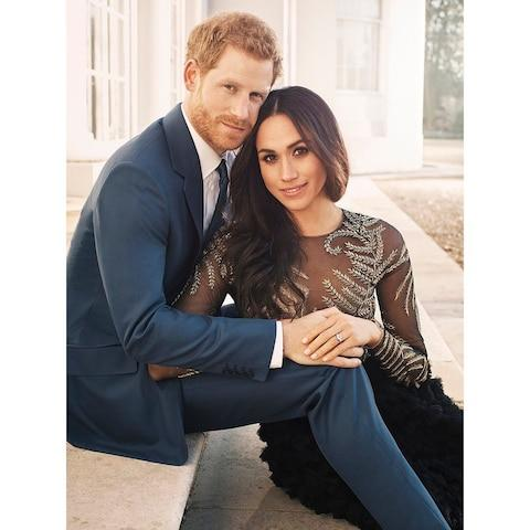 The Royal engagement photo that prompted Samantha Markles Twitter barb about Ms Markle's dress - Credit: PA
