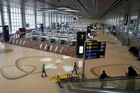 A general view of the check-in area of the departure hall during a media tour of Changi Airport Terminal 4 in Singapore