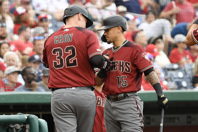 Arizona Diamondbacks' Kevin Cron (32) celebrates his two-run home run with Ildemaro Vargas (15) during the eighth inning of a baseball game against the Washington Nationals, Saturday, June 15, 2019, in Washington. (AP Photo/Nick Wass)