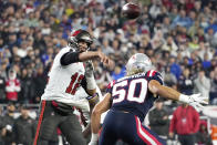 Tampa Bay Buccaneers quarterback Tom Brady (12) throws a pass while pressured by New England Patriots defensive end Chase Winovich (50) during the first half of an NFL football game, Sunday, Oct. 3, 2021, in Foxborough, Mass. (AP Photo/Elise Amendola)