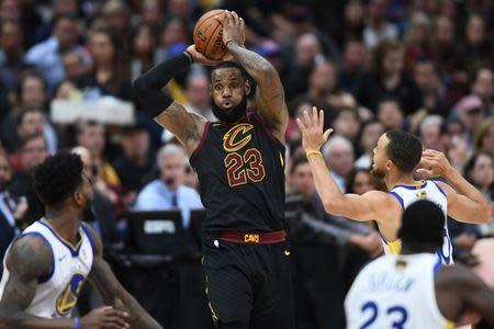 Jun 8, 2018; Cleveland, OH, USA; Cleveland Cavaliers forward LeBron James (23) tries to pass the ball against Golden State Warriors guard Stephen Curry (30) during the third quarter in game four of the 2018 NBA Finals at Quicken Loans Arena. Mandatory Credit: Ken Blaze-USA TODAY Sports