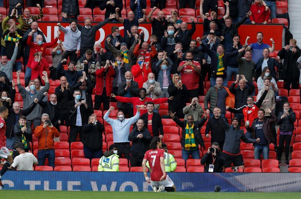 Edinson Cavani celebrates his goal in front of delighted fans at Old Trafford.