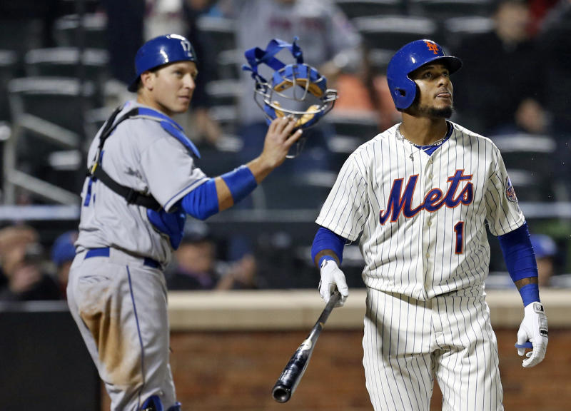 New York Mets' Jordany Valdespin (1) watches his 10th-inning, walk-off grand slam to give the Mets a 7-3 win over the Los Angeles Dodgers in a baseball game at Citi Field in New York, Wednesday, April 24, 2013. Dodgers catcher A.J. Ellis (17) also watches the hit. (AP Photo/Kathy Willens)