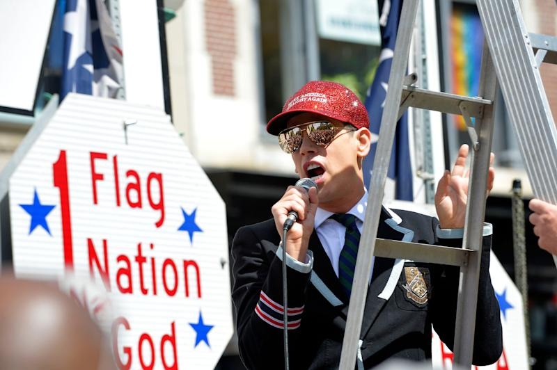 "Milo Yiannopoulos leads a ""Straight Pride"" parade in Boston on Aug. 31, 2019. Supporters of President Donald Trump and counterdemonstrators who called them homophobic extremists staged dueling rallies in Boston."