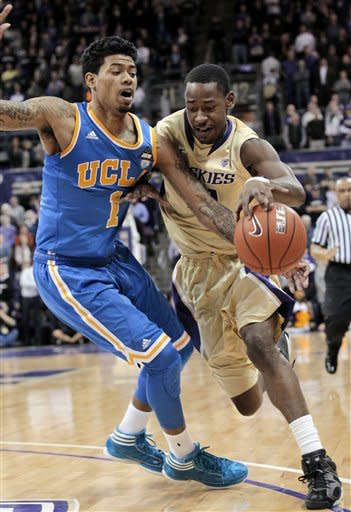 UCLA's Tyler Lamb, left, tries to knock the ball from Washington's Terrence Ross in the first half of an NCAA college basketball game Thursday, Feb. 2, 2012, in Seattle. (AP Photo/Elaine Thompson)