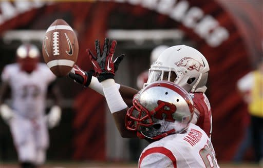 Arkansas cornerback Kaelon Kelleybrew, top, breaks up a pass intended for Rutgers wide receiver Mark Harrison during the first quarter of an NCAA college football game in Fayetteville, Ark., Saturday, Sept. 22, 2012. (AP Photo/Danny Johnston)