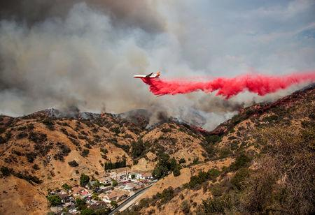 The La Tuna Canyon fire over Burbank. REUTERS/ Kyle Grillot