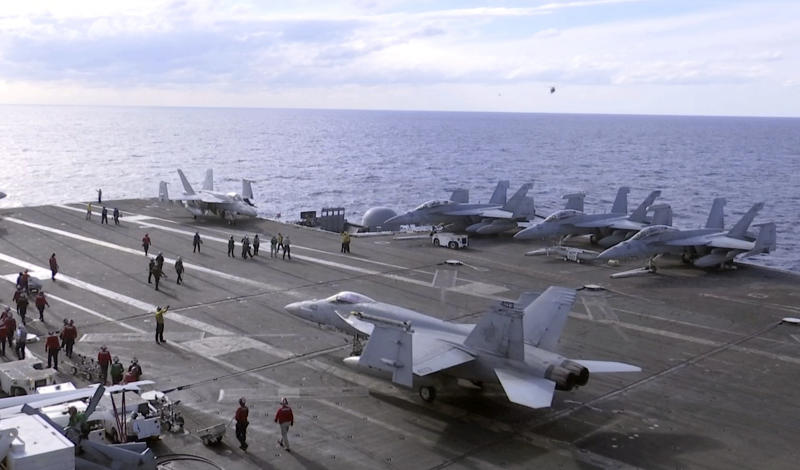 In this image made from Nov. 3, 2018, video, F-18 fighter jets are anchored on the deck of the USS Ronald Reagan during maneuvers in the waters off Iwakuni, Japan. On Monday, while on routine operations in the Philippine Sea, an F-18 from the USS Reagan crashed into the sea but its two aviators were rescued safely. (AP Photo/Richard Columbo)