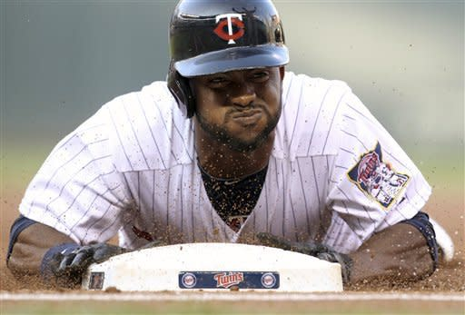 Minnesota Twins center fielder Denard Span (2) is out at first base after being caught off base against the Chicago White Sox during the first inning of a baseball game, Tuesday, July 31, 2012, in Minneapolis. (AP Photo/Genevieve Ross)