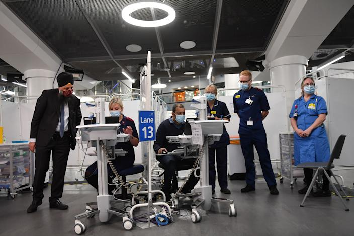 BIRMINGHAM, ENGLAND - JANUARY 11: Members of staff prepare to administer injections of a Covid-19 vaccine at the NHS vaccine centre that has been set up at the Millennium Point centre on January 11, 2021 in Birmingham, England. The location is one of several mass vaccination centres in England to open to the public this week. The UK aims to vaccinate 15 million people by mid-February. (Photo by Jacob King - WPA Pool/Getty Images)