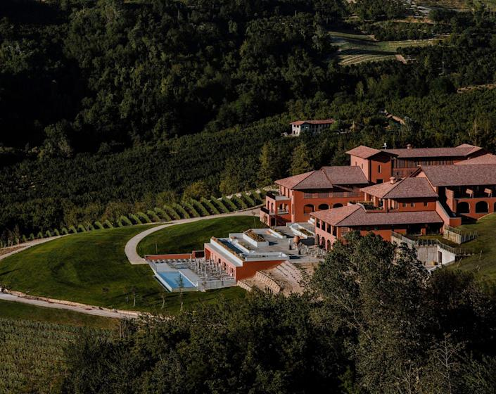 """<p>Italy's Piedmont region is home to some of the world's best old world wines, and now it's home to a five-star, sustainable destination in <a href=""""https://www.casadilanga.com/"""" rel=""""nofollow noopener"""" target=""""_blank"""" data-ylk=""""slk:Casa di Langa"""" class=""""link rapid-noclick-resp"""">Casa di Langa</a>. This gorgeous property is sure to become a haven for foodies, wine enthusiasts, wellness seekers, and history buffs alike for its unique setting, amenities, and experiences. It's home to the world's first truffle concierge and truffle hunting, a wine academy, hands-on cooking classes that demonstrate on-site, farm-to-table initiatives, and a spa focused on sustainable skincare and wellness. </p><p><em>Casa di Langa opened in June 2021. Nightly rates start at $525 in the spring and summer. </em></p>"""