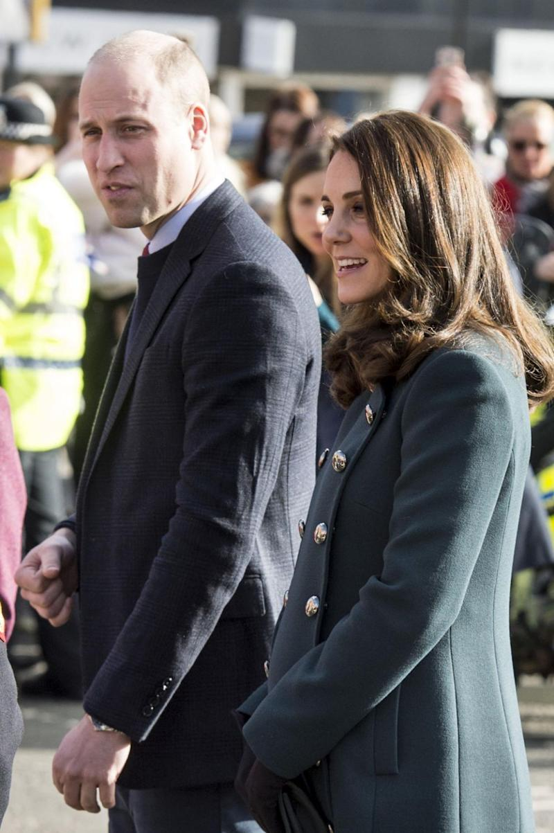 Kate showed off her bump in a fitted green coat. Photo: Getty