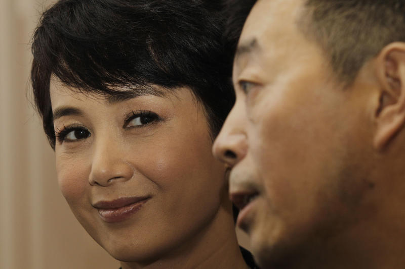 """Chinese director Gu Changwei, right, and his wife Chinese actress Jiang Wenli attend a promotional event of their latest movie """"Till Death Do Us Part"""" in Hong Kong Tuesday, March 22, 2011, as part of the events in Hong Kong International Film Festival. (AP Photo/Kin Cheung)"""