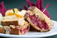 """<p><strong>Reuben Sandwich</strong></p><p>While it may not have been invented in Michigan, no one does Reuben Sandwiches like the delis in Detroit -- especially <a href=""""https://www.zingermansdeli.com/"""" rel=""""nofollow noopener"""" target=""""_blank"""" data-ylk=""""slk:Zingerman's Deli"""" class=""""link rapid-noclick-resp"""">Zingerman's Deli</a>. Thinly sliced corned beef and Swiss cheese, piled high only buttery rye bread, finished off with sauerkraut and Russian dressing. You can't go wrong grilled or hot-pressed. </p>"""