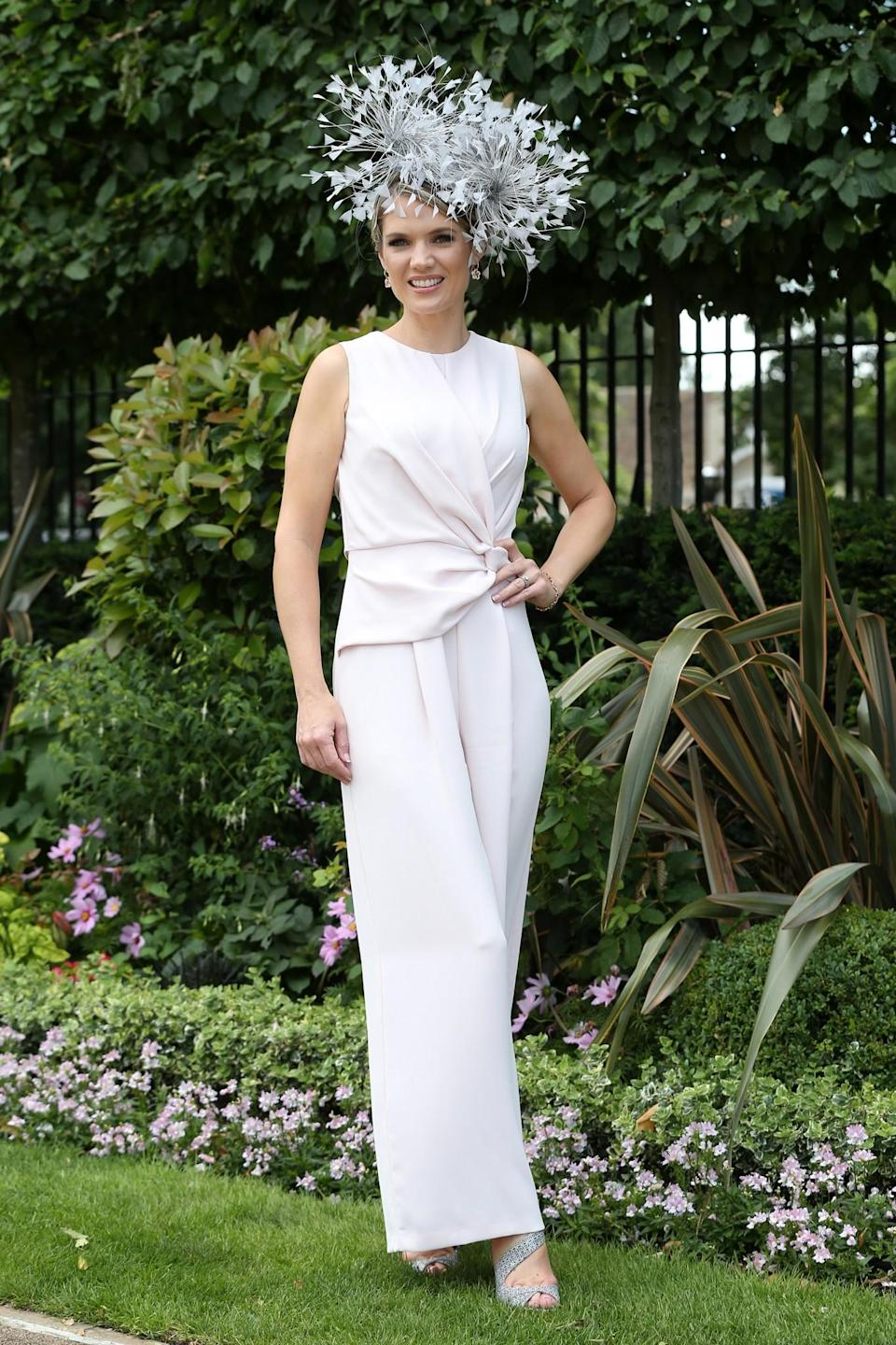 <p>The TV presenter looked staturesque in a white jumpsuit and statement hat on day four of Royal Ascot 2017. <br><em>[Photo: PA]</em> </p>