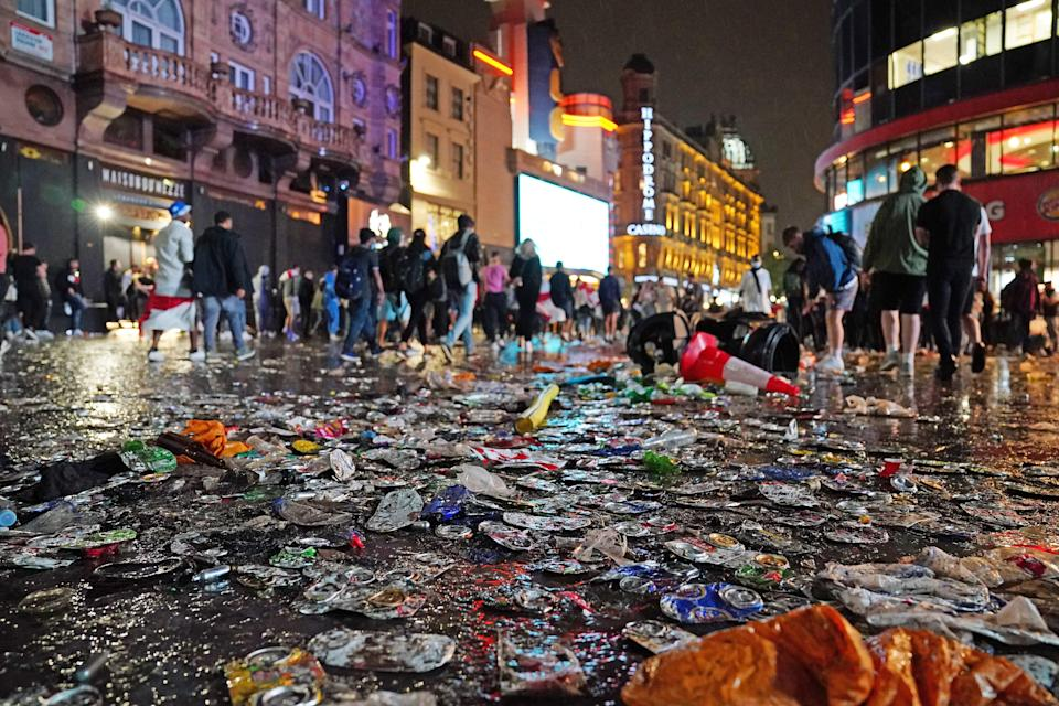 Debris covers a street in London's Leicester Square after Italy won the Uefa Euro 2020 Final against England (Aaron Chown/PA) (PA Wire)