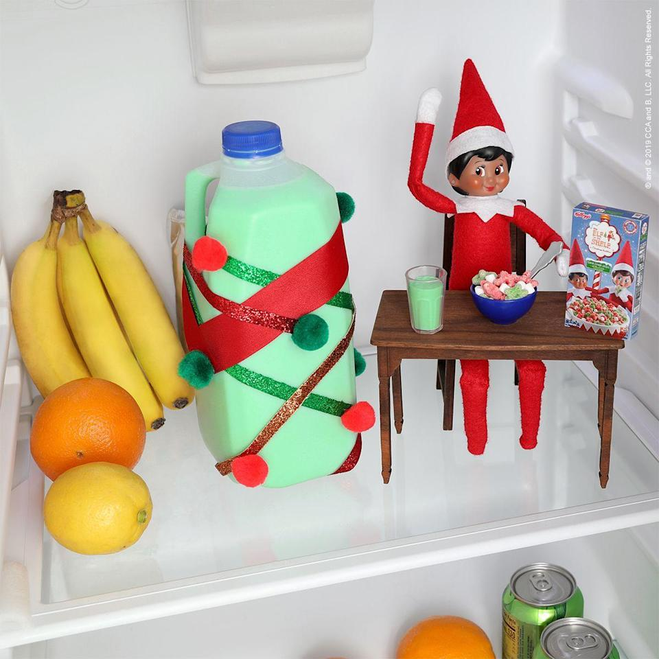 """<p>Green milk, a tiny table, and even some Scout Elf cereal are just the things to surprise your kids with on Christmas morning. Let's just hope your Elf is in the mood to share!</p><p><strong>Get the tutorial at <a href=""""https://elfontheshelf.com/elf-ideas/breakfast-of-scout-elf-champions/"""" rel=""""nofollow noopener"""" target=""""_blank"""" data-ylk=""""slk:Elf on the Shelf"""" class=""""link rapid-noclick-resp"""">Elf on the Shelf</a>.</strong></p><p><a class=""""link rapid-noclick-resp"""" href=""""https://go.redirectingat.com?id=74968X1596630&url=https%3A%2F%2Fwww.walmart.com%2Fsearch%2F%3Fquery%3Delf%2Bon%2Bthe%2Bshelf&sref=https%3A%2F%2Fwww.thepioneerwoman.com%2Fholidays-celebrations%2Fg34080491%2Ffunny-elf-on-the-shelf-ideas%2F"""" rel=""""nofollow noopener"""" target=""""_blank"""" data-ylk=""""slk:SHOP ELF ON THE SHELF"""">SHOP ELF ON THE SHELF</a><strong><br></strong></p>"""