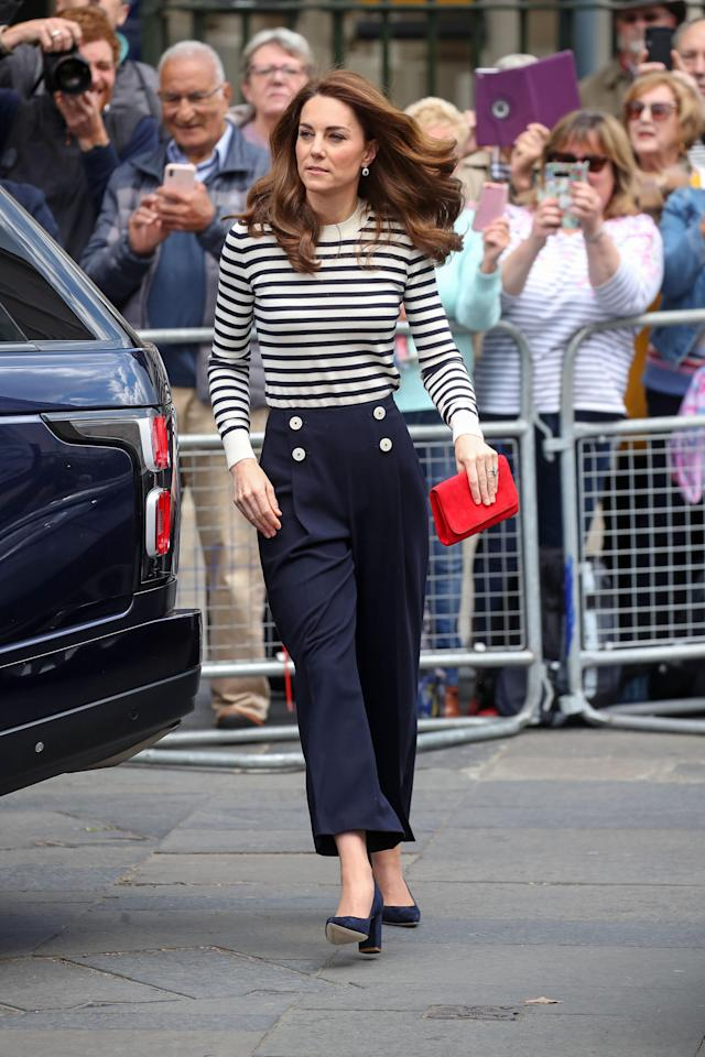 Kate Middleton accessorised the L.K. Bennett trousers with a Breton-striped jumper, court shoes and red bag. (Getty images)