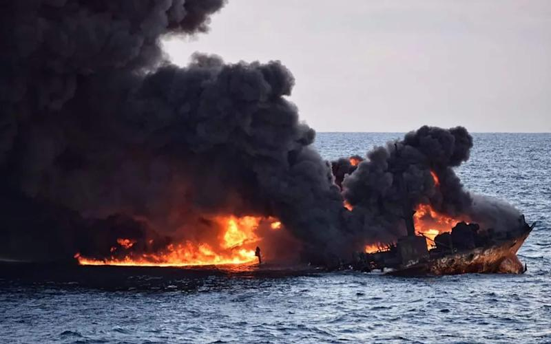 Ministry of China released on January 14, 2018 shows smoke and flames coming from the burning oil tanker
