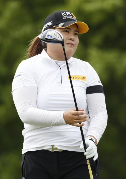 Inbee Park, of South Korea, watches her shot off the the 10th tee during the second round of the KPMG Women's PGA Championship golf tournament, Friday, June 21, 2019, in Chaska, Minn. (AP Photo/Charlie Neibergall)