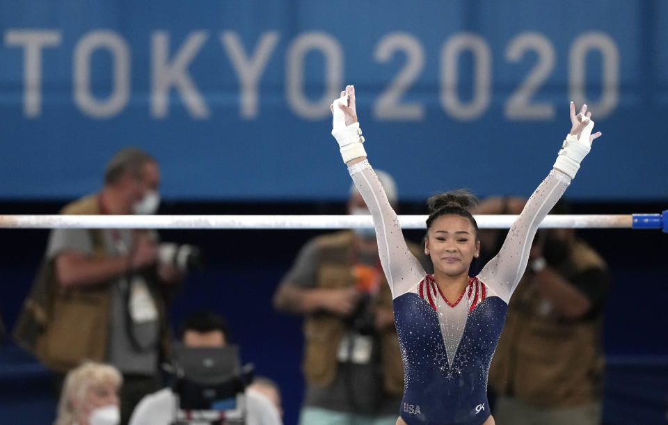 Sunisa Lee, of the United States, finishes on the uneven bars during the artistic gymnastics women's all-around final at the 2020 Summer Olympics, Thursday, July 29, 2021, in Tokyo. (AP Photo/Ashley Landis)