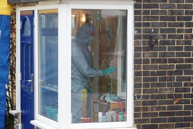 A forensic officer enters the house in Freemens Way in Deal