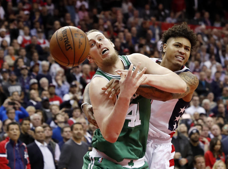 Boston Celtics center Kelly Olynyk is fouled by Washington Wizards forward Kelly Oubre Jr. on an inbounds pass during the fourth quarter of Game 6. (AP)