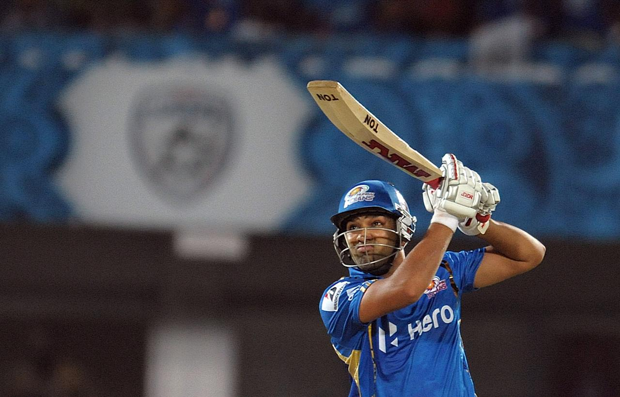 Mumbai Indians batsman Rohit Sharma plays a shot during the IPL Twenty20 cricket match between Deccan Chargers and Mumbai Indians at Dr. Y.S. Rajasekhara Reddy Cricket Stadium in Visakhapatnam on April 9, 2012.  AFP PHOTO / Noah SEELAM   RESTRICTED TO EDITORIAL USE. MOBILE USE WITHIN NEWS PACKAGE (Photo credit should read NOAH SEELAM/AFP/Getty Images)