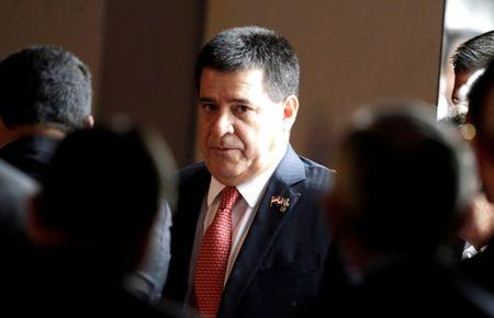 Paraguay's President Horacio Cartes arrives before attending a business forum at the Annual Meeting of the Board of Governors of the Inter-American Development Bank in Luque
