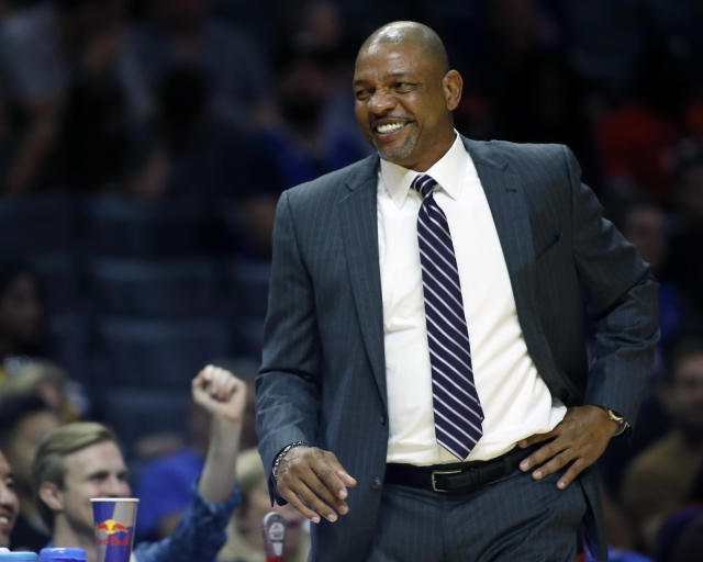 FILE - In this Oct. 8, 2017, file photo, Los Angeles Clippers head coach Doc Rivers smiles during the second half of a preseason NBA basketball game against the Portland Trail Blazers, in Los Angeles. The Clippers and coach Doc Rivers have agreed to a contract extension that will keep him around to oversee the post-Lob City era. The team announced the extension Wednesday, May 23, 2018, while not disclosing terms of the deal.(AP Photo/Alex Gallardo, FIle)