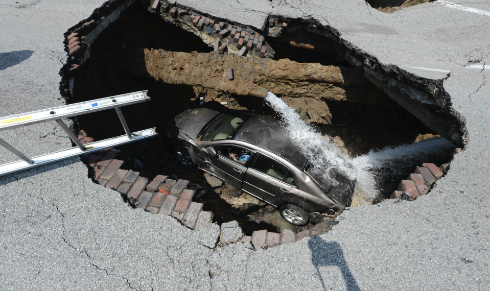 Sinkholes, like this one in Ohio, can be caused by shoddy construction. (Photo: REUTERS/Lt. Matthew Hertzfeld/Toledo Fire)