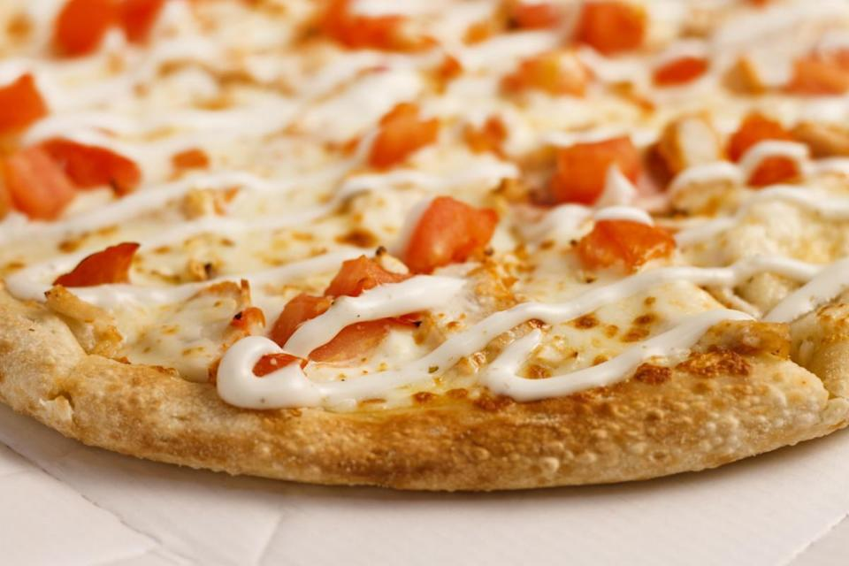 """<p>Speaking of things that do or do not belong on pizza: Is ranch a suitable dipping sauce or drizzle on a pie? New Yorkers generally rage against ranch on pizza, with New York food writer Ed Levine calling it """"a crime against nature."""" However, most <a href=""""https://www.thedailymeal.com/eat/favorite-pizza-chains?referrer=yahoo&category=beauty_food&include_utm=1&utm_medium=referral&utm_source=yahoo&utm_campaign=feed"""" rel=""""nofollow noopener"""" target=""""_blank"""" data-ylk=""""slk:national pizza chains"""" class=""""link rapid-noclick-resp"""">national pizza chains</a> let you order your pizza with a side of ranch.</p>"""
