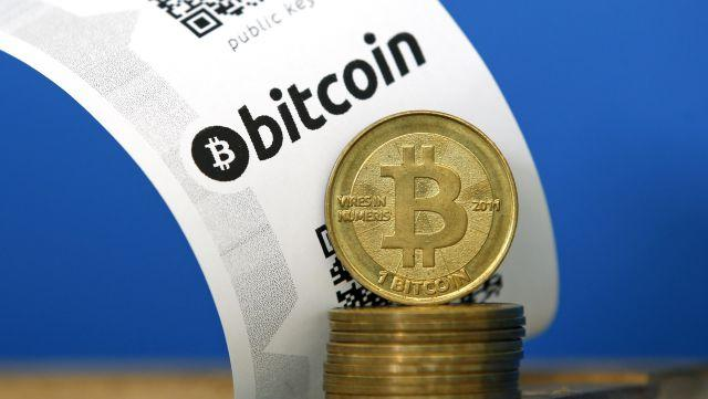 A Bitcoin (virtual currency) paper wallet with QR codes .