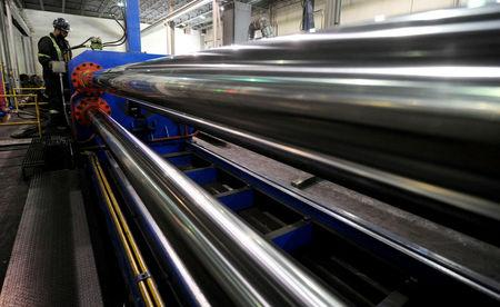 Workers are seen at Bri-Steel Manufacturing, a manufacturer and distributer of seamleass steel pipes, in Edmonton