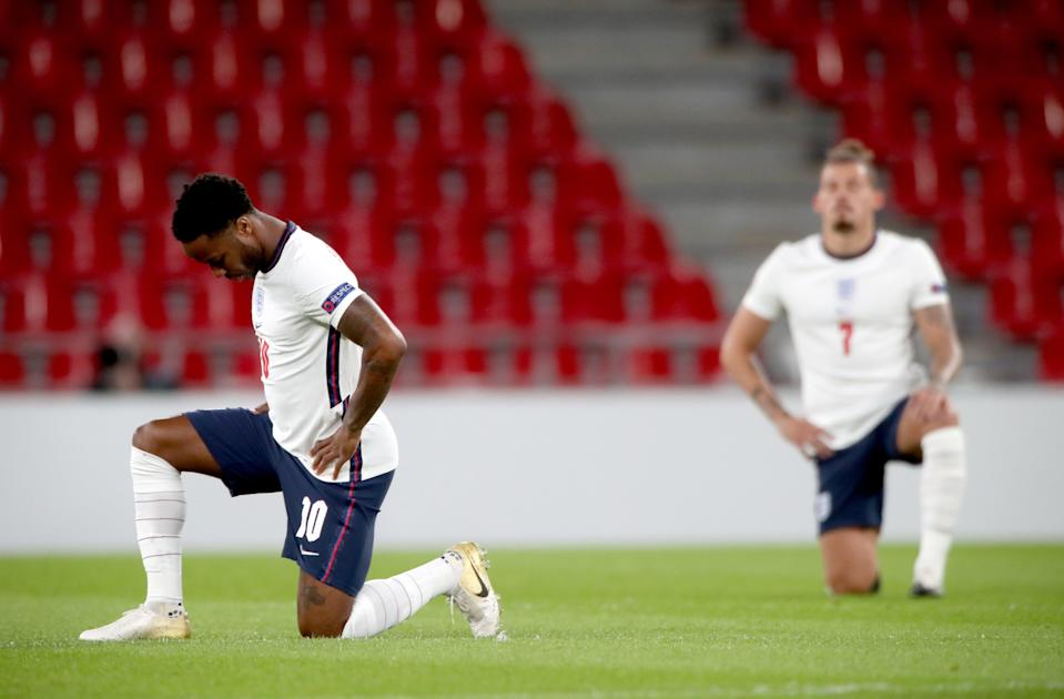 England players taking a knee (PA Wire)