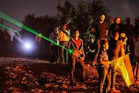 Palestinian protesters in Beita use laser pointers during a demonstration against the Israeli settler outpost of Eviatar on July 1, 2021