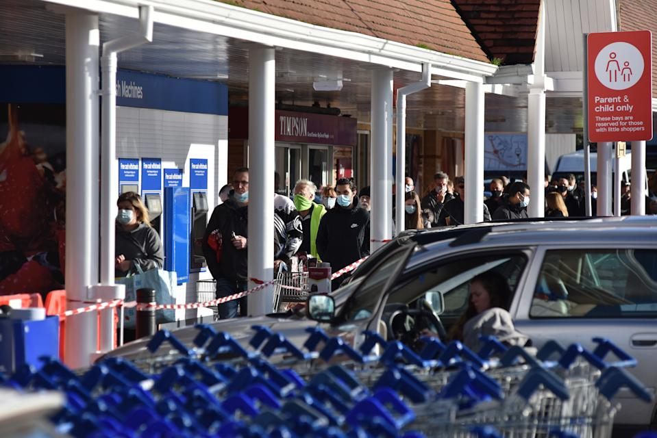 SOUTHEND, ENGLAND - DECEMBER 20: People start to queue at Tesco supermarket as Essex goes into tier 4 on December 20, 2020 in Southend on Sea, England. As from today all non essential shops and retailers will close in areas including London, Kent, Essex and Bedfordshire. People in tier four can now not mix indoors with anyone not from their household. (Photo by John Keeble/Getty Images)