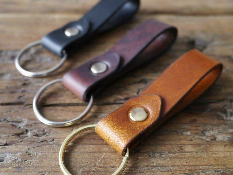 """<p><strong>KingsleyLeather</strong></p><p>etsy.com</p><p><strong>$28.32</strong></p><p><a href=""""https://go.redirectingat.com?id=74968X1596630&url=https%3A%2F%2Fwww.etsy.com%2Flisting%2F489466154%2Fleather-key-fob-leather-key-chain&sref=https%3A%2F%2Fwww.goodhousekeeping.com%2Fchildrens-products%2Ftoy-reviews%2Fg29645332%2Fbest-toys-gifts-for-13-year-old-boys%2F"""" rel=""""nofollow noopener"""" target=""""_blank"""" data-ylk=""""slk:Shop Now"""" class=""""link rapid-noclick-resp"""">Shop Now</a></p><p>If he's always losing track of his keys, maybe this very adult-looking key fob will give him the motivation he needs to keep track of it. (You can always put a <a href=""""https://www.amazon.com/Tile-RE-19001-Mate-1-Pack/dp/B07W9BBCTB?tag=syn-yahoo-20&ascsubtag=%5Bartid%7C10055.g.29645332%5Bsrc%7Cyahoo-us"""" rel=""""nofollow noopener"""" target=""""_blank"""" data-ylk=""""slk:Tile Bluetooth tracker"""" class=""""link rapid-noclick-resp"""">Tile Bluetooth tracker</a> on it for extra peace of mind.) You can get it with silver, gold or brass hardware. </p>"""