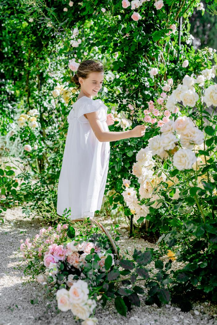 "<div class=""caption""> Douzal's nine-year-old daughter, Athina, in the rose garden. </div>"