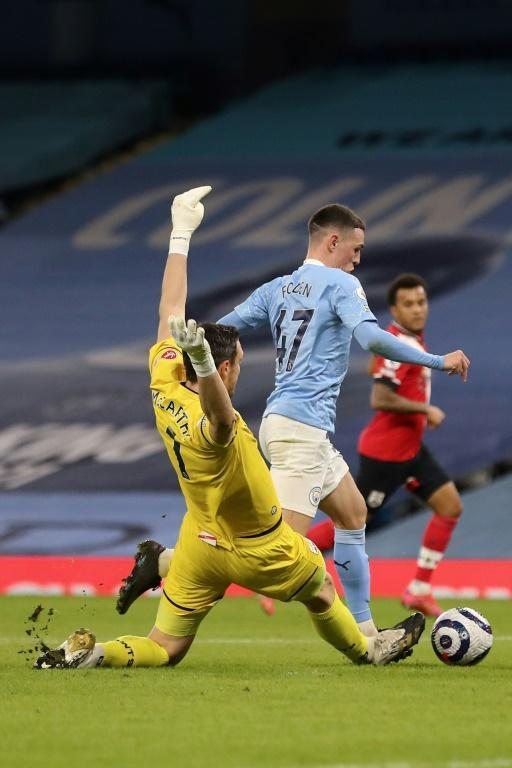 Not paying the penalty: Southampton goalkeeper Alex McCarthy (left) escaped without conceding a penalty for tripping Phil Foden (right)